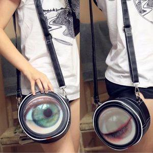 Handbags - Winking eye ball shoulder purse